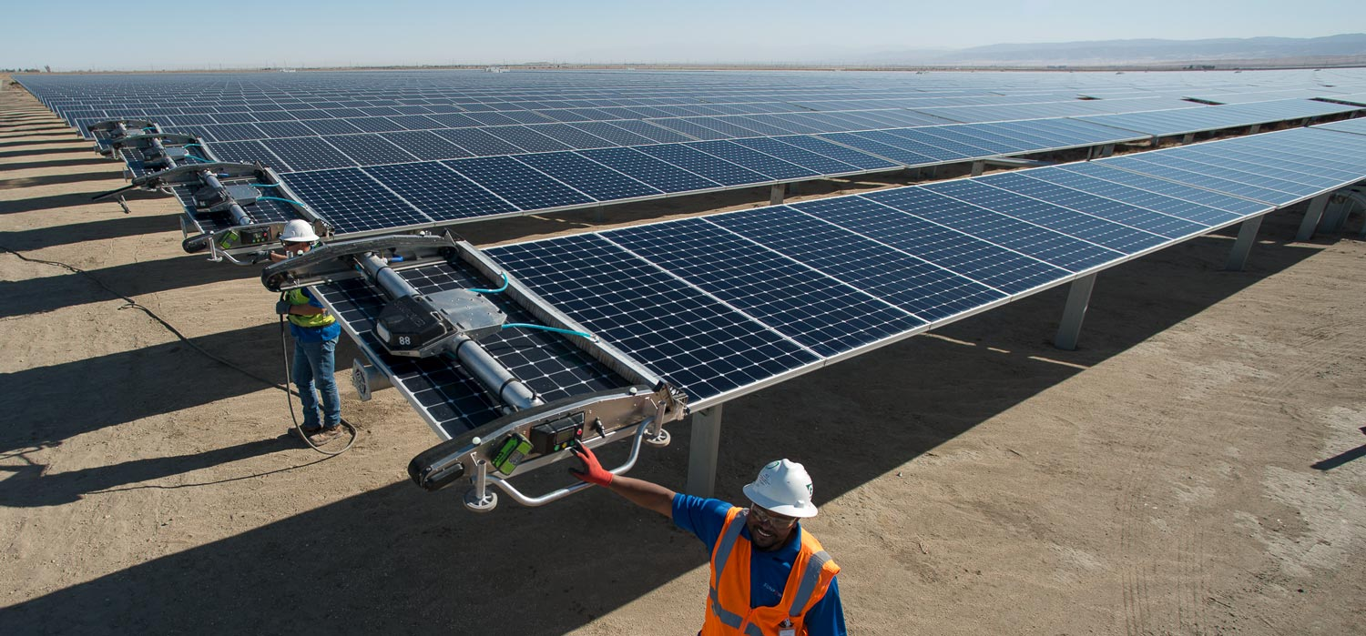 Robots clean a solar panel