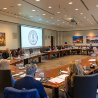 Wide view of the Board of Trustees meeting.