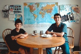 Ross Venook and his son sitting at a table with food