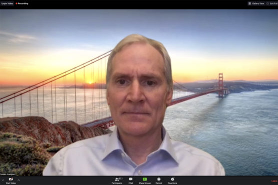 Marc Tessier-Lavigne in front of a screen showing the Golden Gate Bridge
