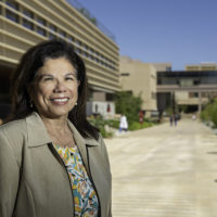 Yvonne Maldonado in front of a building on the Stanford campus