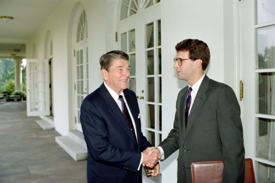 Robinson shakes Reagan's hand in the portico outside the oval office