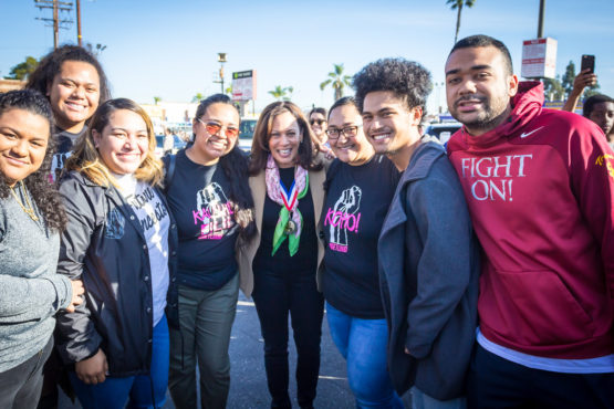 Kamala Harris with a group of people at the Los Angeles Kingdom Day Parade 2018