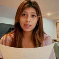 Mila Camargo holding paper