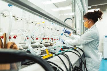Cecilia Endriga working in the lab