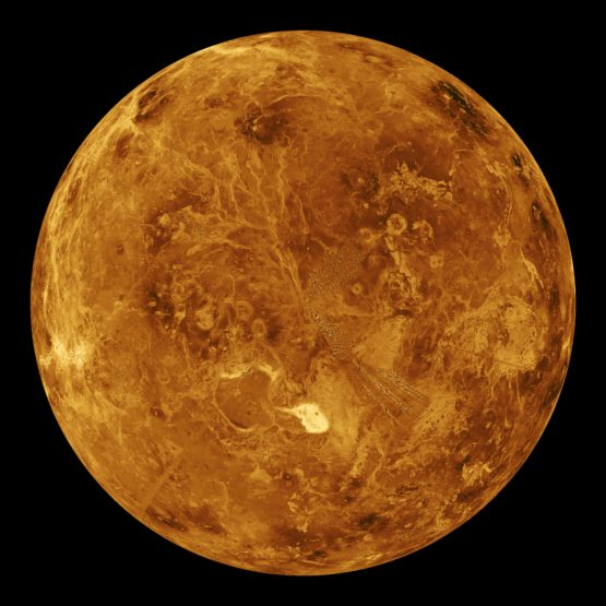 Venus looks orange and red against a black background