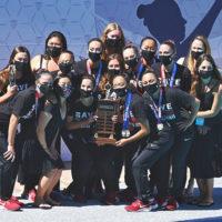Women in masks holding trophy