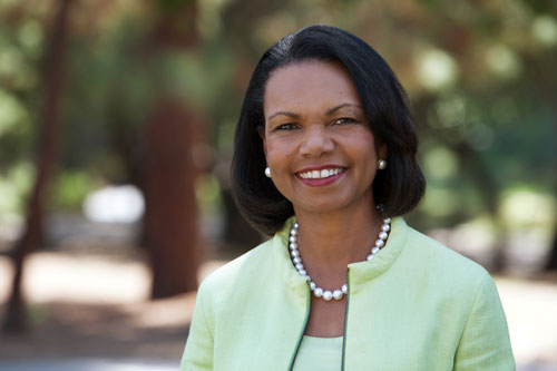 Photo of Condoleezza Rice wearing a light green suit.