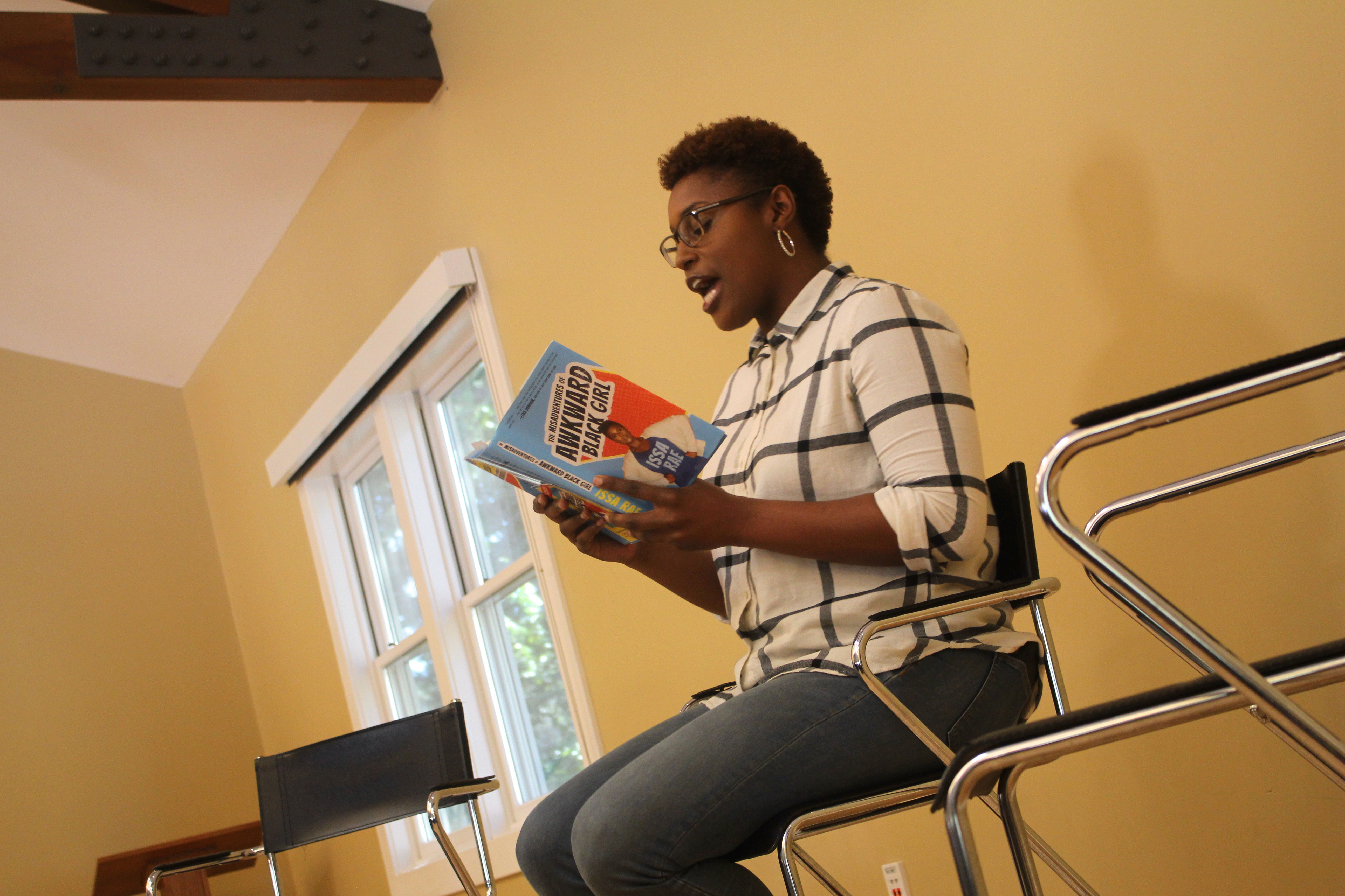 "Issa Rae reading her book, ""Misadventures of Awkward Black Girl"""