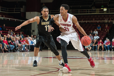 hoto of Stanford senior and men's basketball player Anthony Brown dribbling down the court and being guarded by a Vanderbilt player. Photo credit David Bernal/isiphotos.com