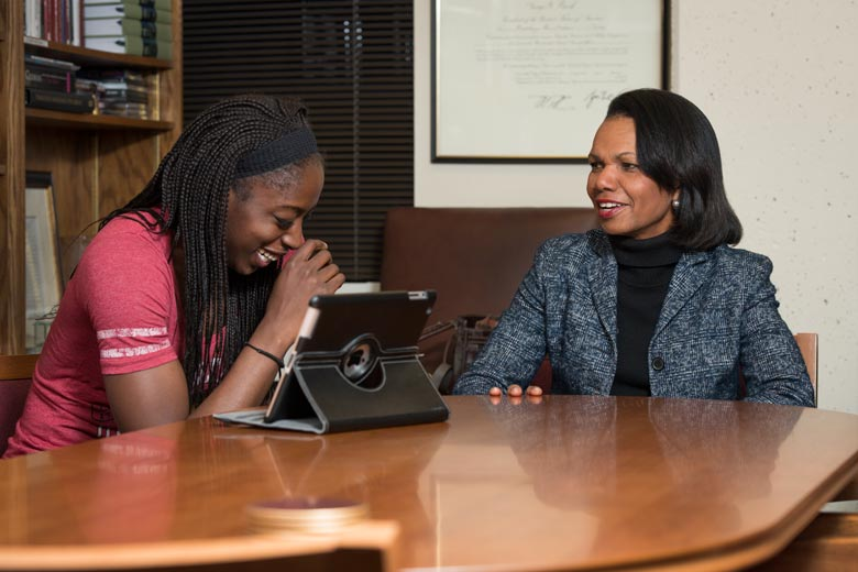 Photo of former Stanford women's basketball star Chiney Ogwumike '14, and her adviser Professor Condoleezza Rice in 2014. (Photo credit: L.A. Cicero)