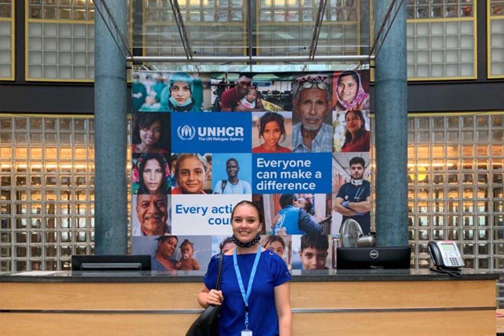 Stanford senior Eva Hangartner in from of a UNHCR banner