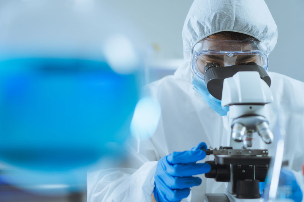 Lab researcher looking into a microscope