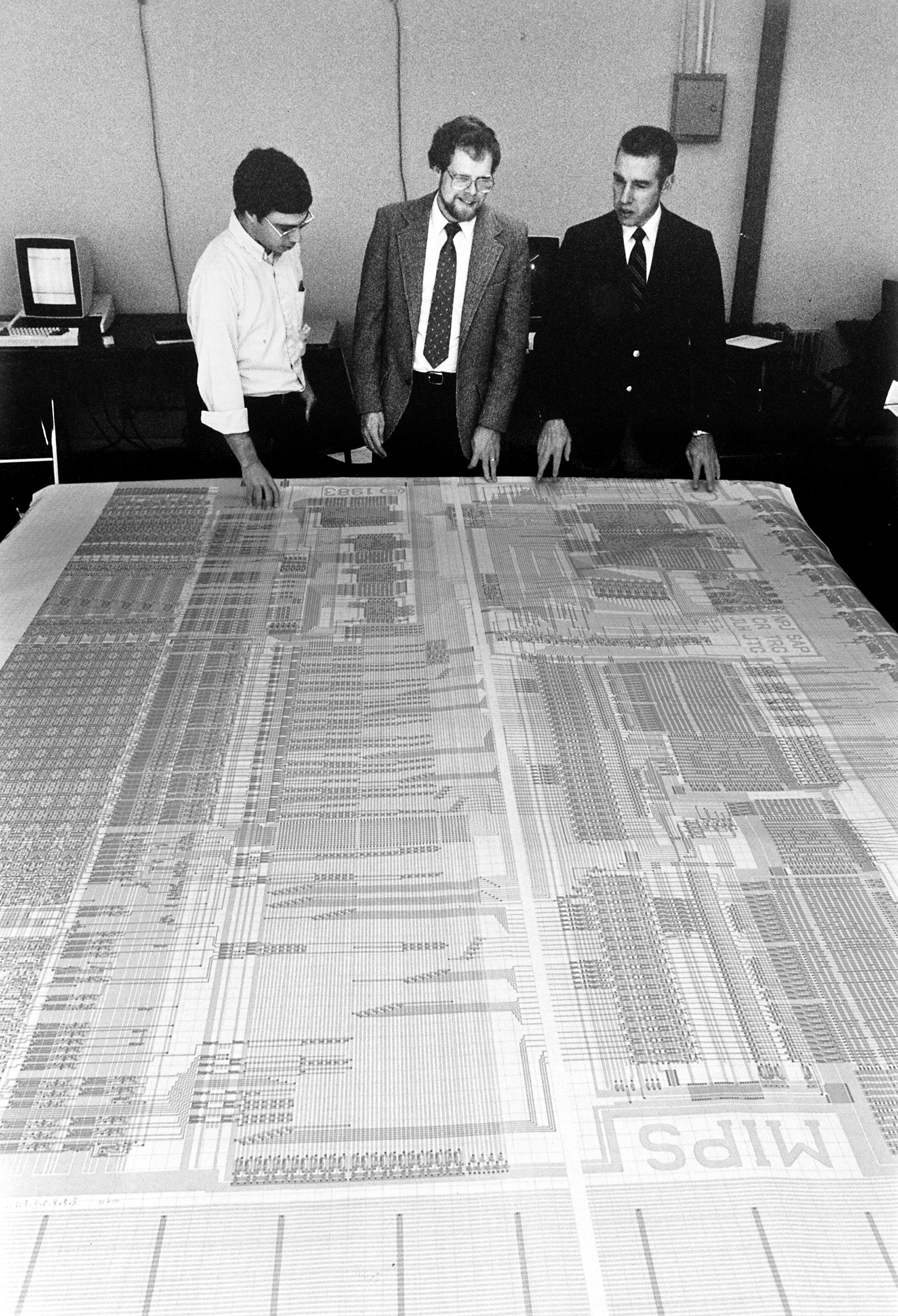 computer scientists with large printout