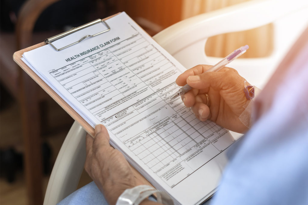 Health insurance claim form application for patient with illness in hospital ward.