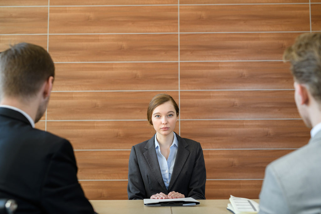 Woman in a business meeting with two men.