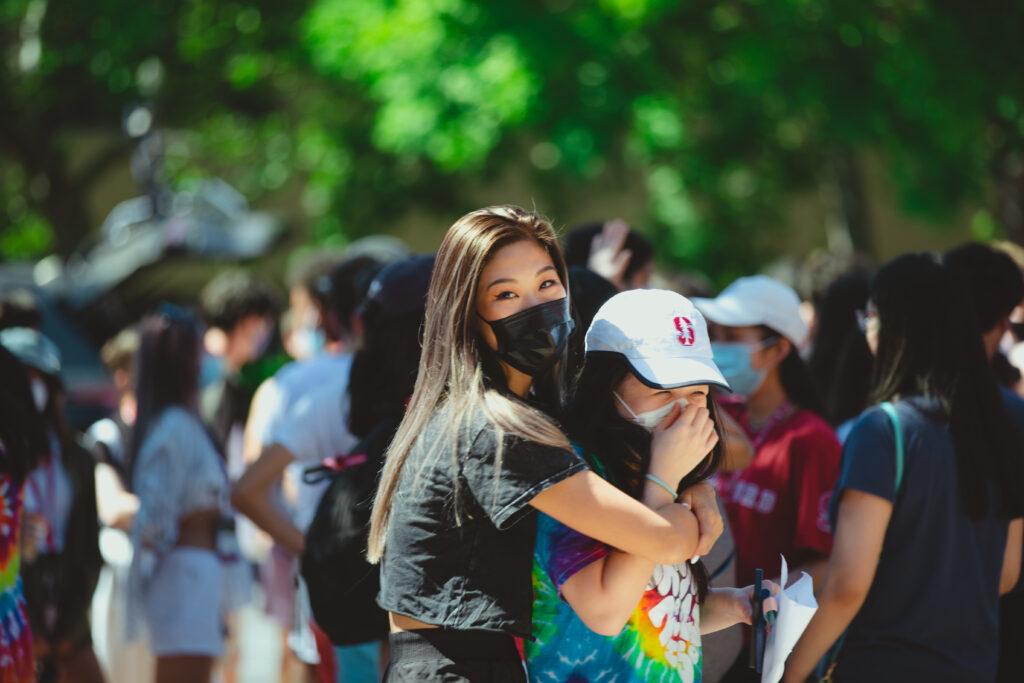 Two female international undergraduate students hug during orientation this fall